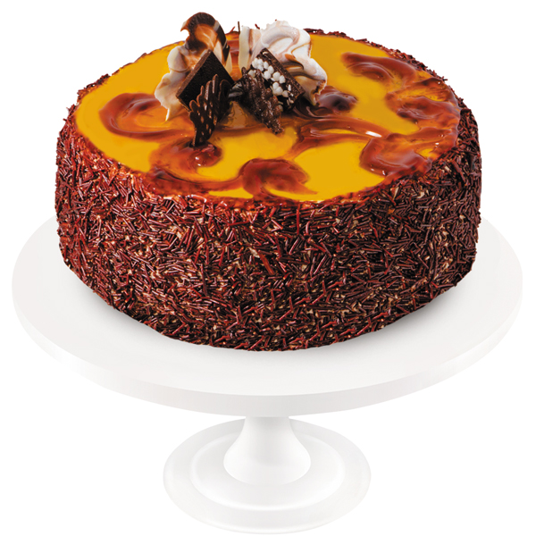 Chocolate sponge cake soaked in syrup, with delicate dairy cream and marzipans. The cake is artfully decorated with caramel confectionery gel and dark and white chocolate ornaments.