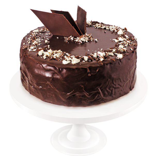 A fine combination of vanilla sponge cake soaked in syrup, with a layer of boiled condensed milk and dairy cream spiked with rum. The cake is covered in chocolate icing and decorated with flamboyant ornaments.